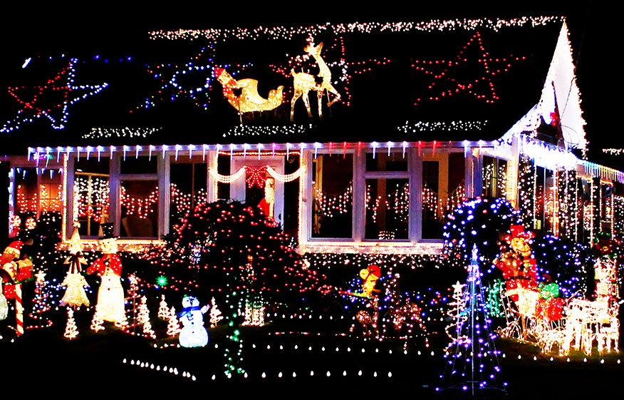 a house decked out in christmas lights at night