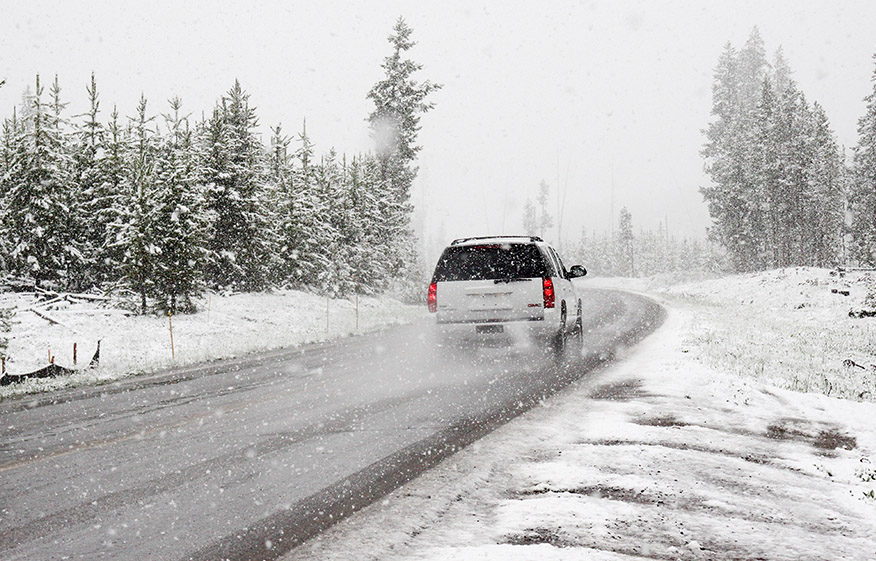 a car driving in the snow
