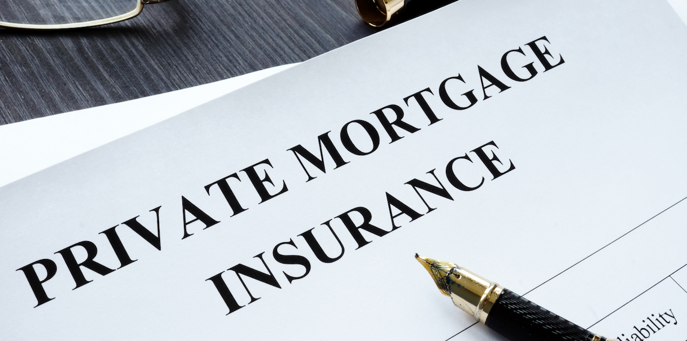"document with ""private mortgage insurance"" written at the top and a fountain pen"