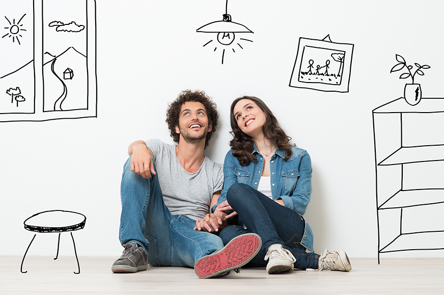 a couple sits on the floor and looks up with illustrations drawn around them on the walls