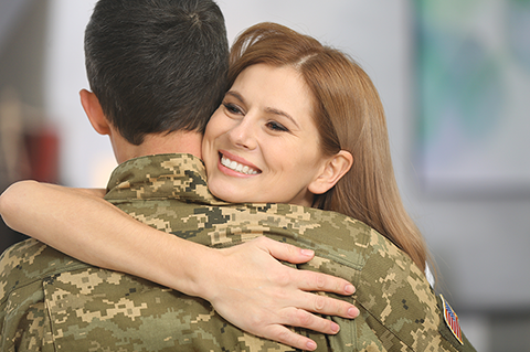 Woman hugging servicemember