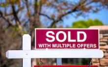 Real estate sign: Sold with multiple offers